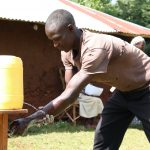 The Water Project: Eluhobe Community, Amadi Spring -  Handwashing Demonstration