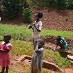 The Water Project: Shikhombero Community, Atondola Spring -  Trainer Adelaide Uses The Camera