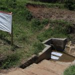The Water Project: Shihingo Community, Mangweli Spring -  Installed Charts Next To The Spring