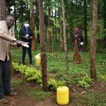 The Water Project: Namarambi Community, Iddi Spring -  Community Elder Demonstrates Handwashing