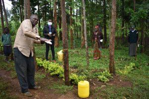 The Water Project:  Community Elder Demonstrates Handwashing