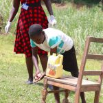 The Water Project: Emachembe Community, Mukabane Spring -  A Girl Demonstrating Handwashing