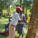 The Water Project: Munenga Community, Burudi Spring -  Handwashing Demonstration With Leaky Tin