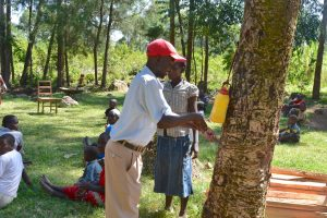 The Water Project:  Handwashing Demonstration With Leaky Tin