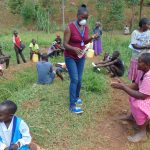 The Water Project: Shitaho Community B, Isaac Spring -  Sanitizing Community Members Hands