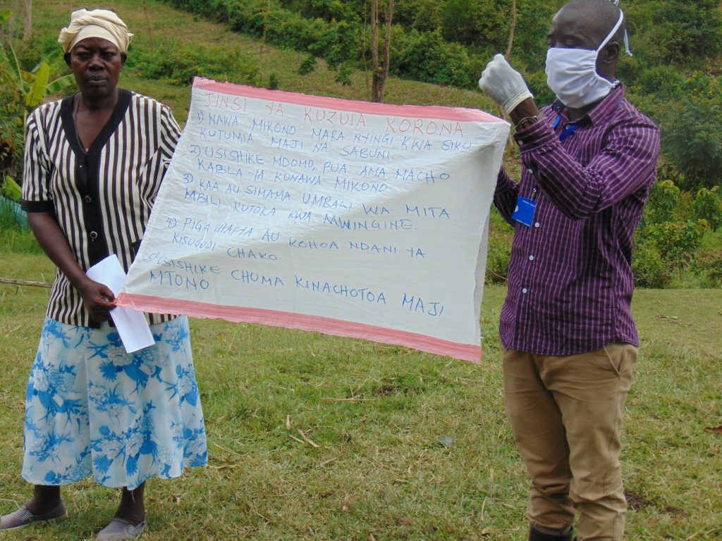 The Water Project : 8-kenya18102-covid19-using-caution-chart-at-the-training
