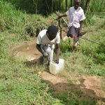 The Water Project: Mukoko Community, Mshimuli Spring -  A Boy Helping To Make A Leaky Tin