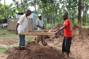 The Water Project:  Community Members Sifting Sand For Tank Plaster