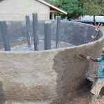 The Water Project: Kapsaoi Primary School -  Plastering Outside Tank