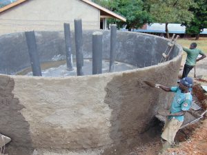 The Water Project:  Plastering Outside Tank