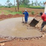 The Water Project: Jinjini Friends Primary School -  Laying Foundation With Concrete