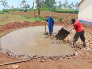 The Water Project:  Laying Foundation With Concrete