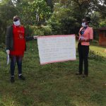 The Water Project: Shirakala Community, Ambani Spring -  The Facilitators Holding Up The Reminder Chart