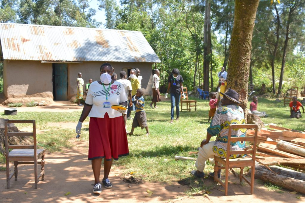 The Water Project : 9-covid19-kenya19176-through-with-training-onto-the-next-community