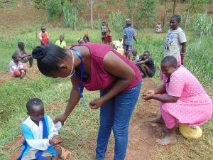 The Water Project:  Sanitizing Community Members Hands