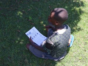The Water Project:  A Child Follows The Covid Sensitization Using Issued Pamphlets
