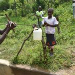 The Water Project: Mukoko Community, Mshimuli Spring -  Trainer Erick Demonstrating Handwashing