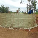 The Water Project: Jinjini Friends Primary School -  Sacks Tied To Wire To Hold Plaster
