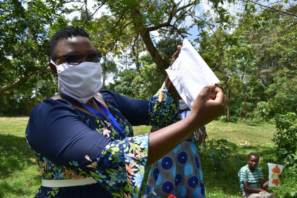 The Water Project : covid19-kenya18092-facilitator-shows-hand-made-mask