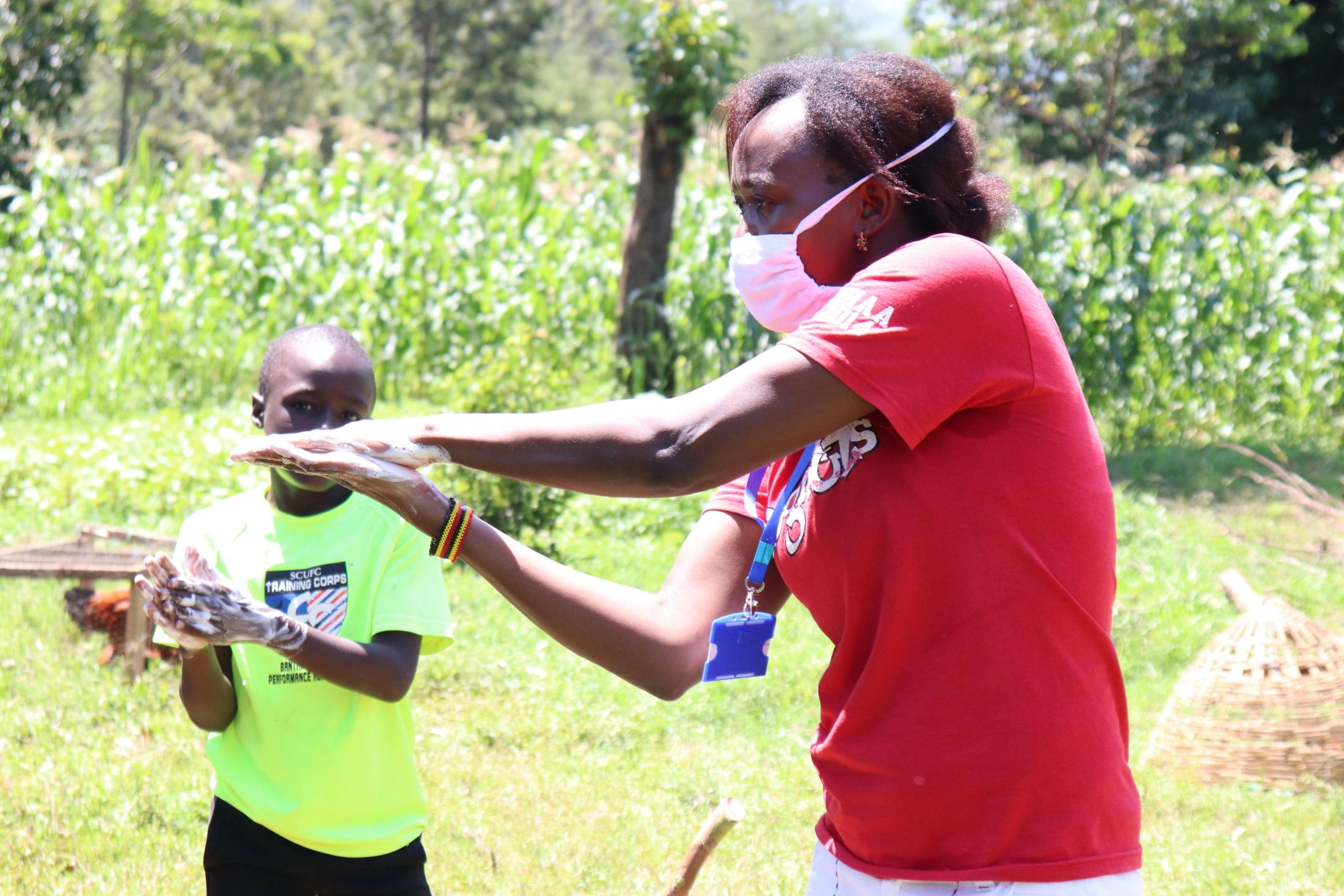 The Water Project : covid19-kenya18122-handwashing-demonstration