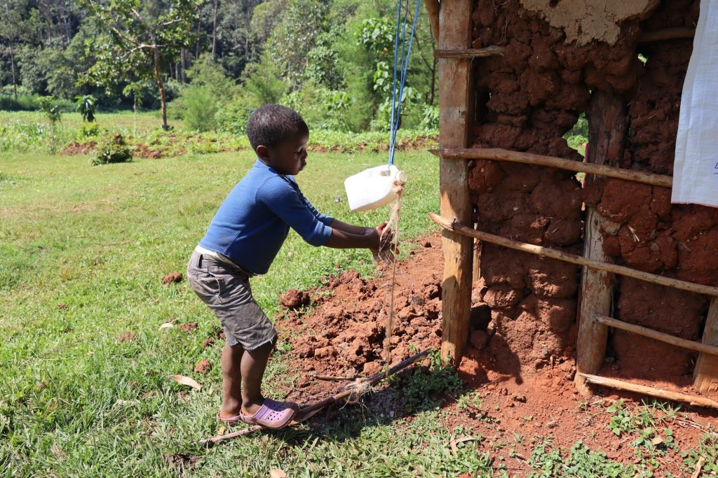 The Water Project : covid19-kenya18168-child-washing-hands