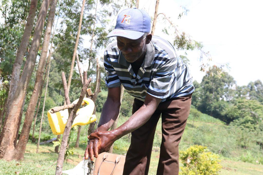 The Water Project : covid19-kenya19125-handwashing-at-the-new-handwashing-station