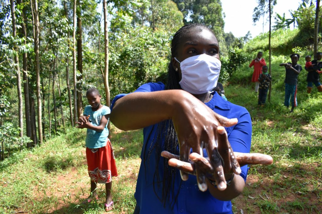 The Water Project : covid19-kenya19150-facilitator-alulu-leading-the-training