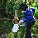 The Water Project: Bukhaywa Community, Ashikhanga Spring -  Filling The Handwashing Container With Clean Water