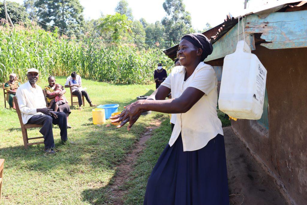 The Water Project : covid19-kenya19168-community-health-worker-leads-handwashing-training