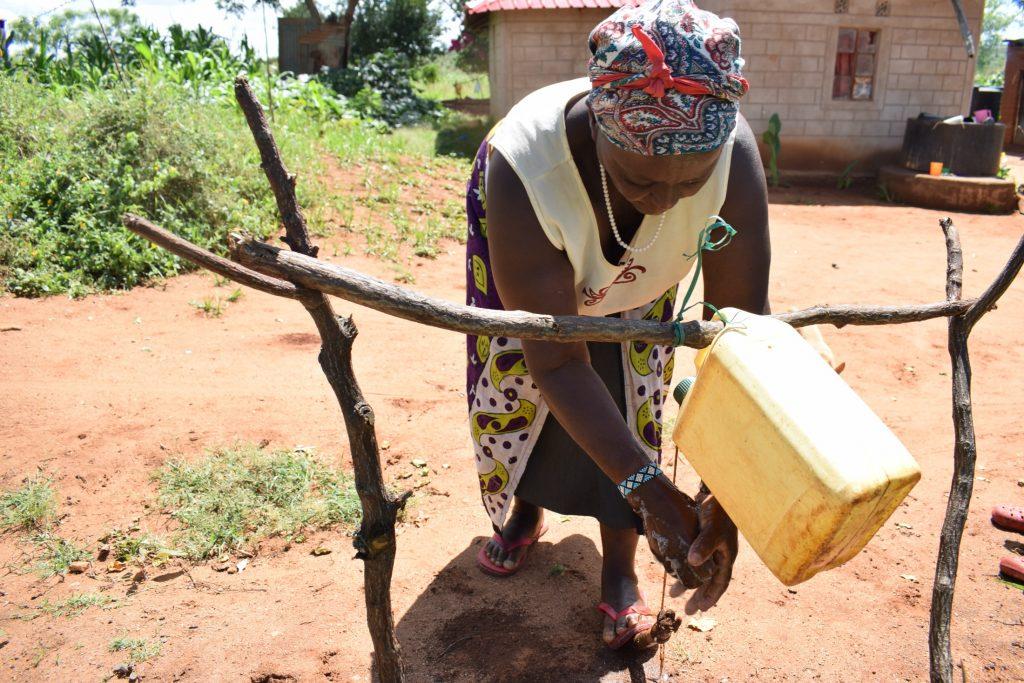 The Water Project : covid19-kenya19188_wathi-muisyo-70-years-washing-her-hands