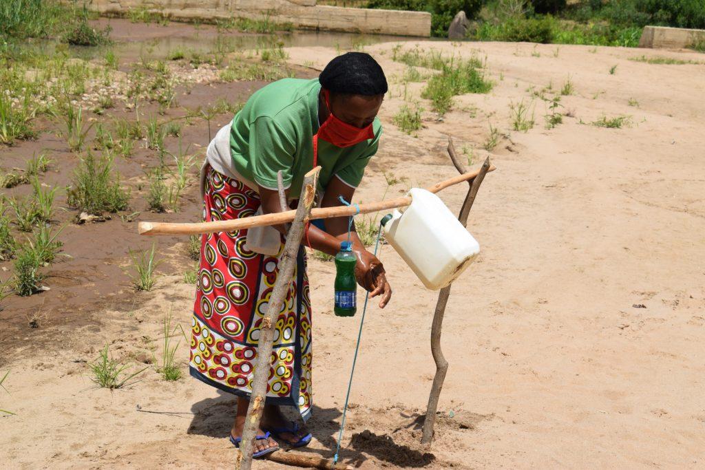 The Water Project : covid19-kenya19207-handwashing-4