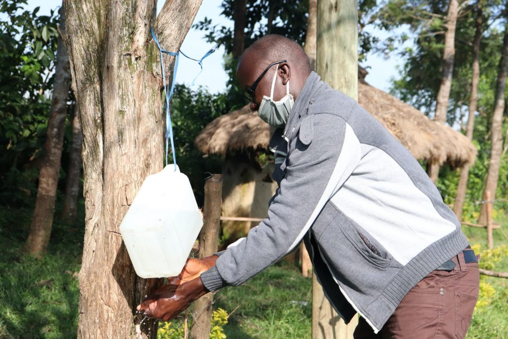 The Water Project : covid19-kenya4294-using-a-setup-leaky-tin-for-handwashing