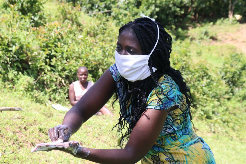 The Water Project : covid19-kenya4564-the-facilitator-demonstrating-the-ten-steps-of-handwashing