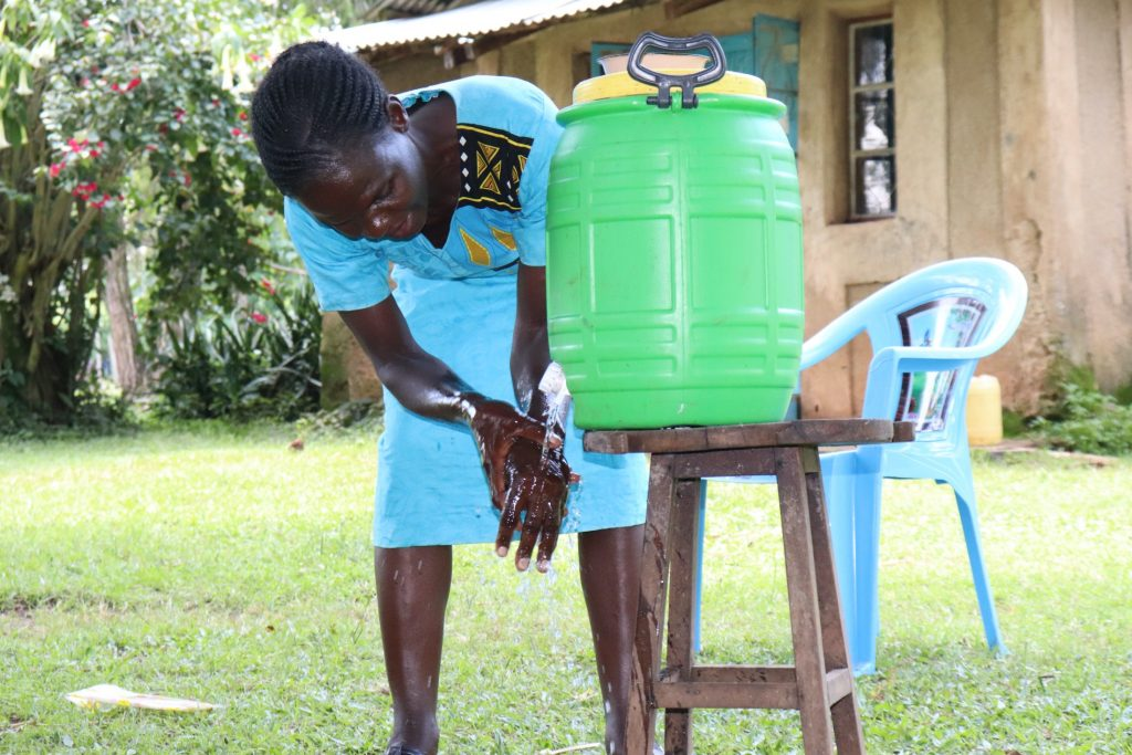 The Water Project : covid19-kenya4856-a-plastic-tank-handwashing-station