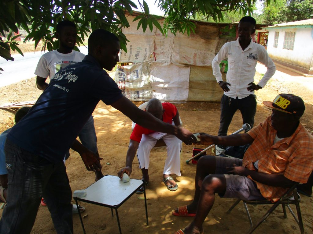 The Water Project : covid19-sierraleone19259-staff-distributing-soap-for-hand-washing-3