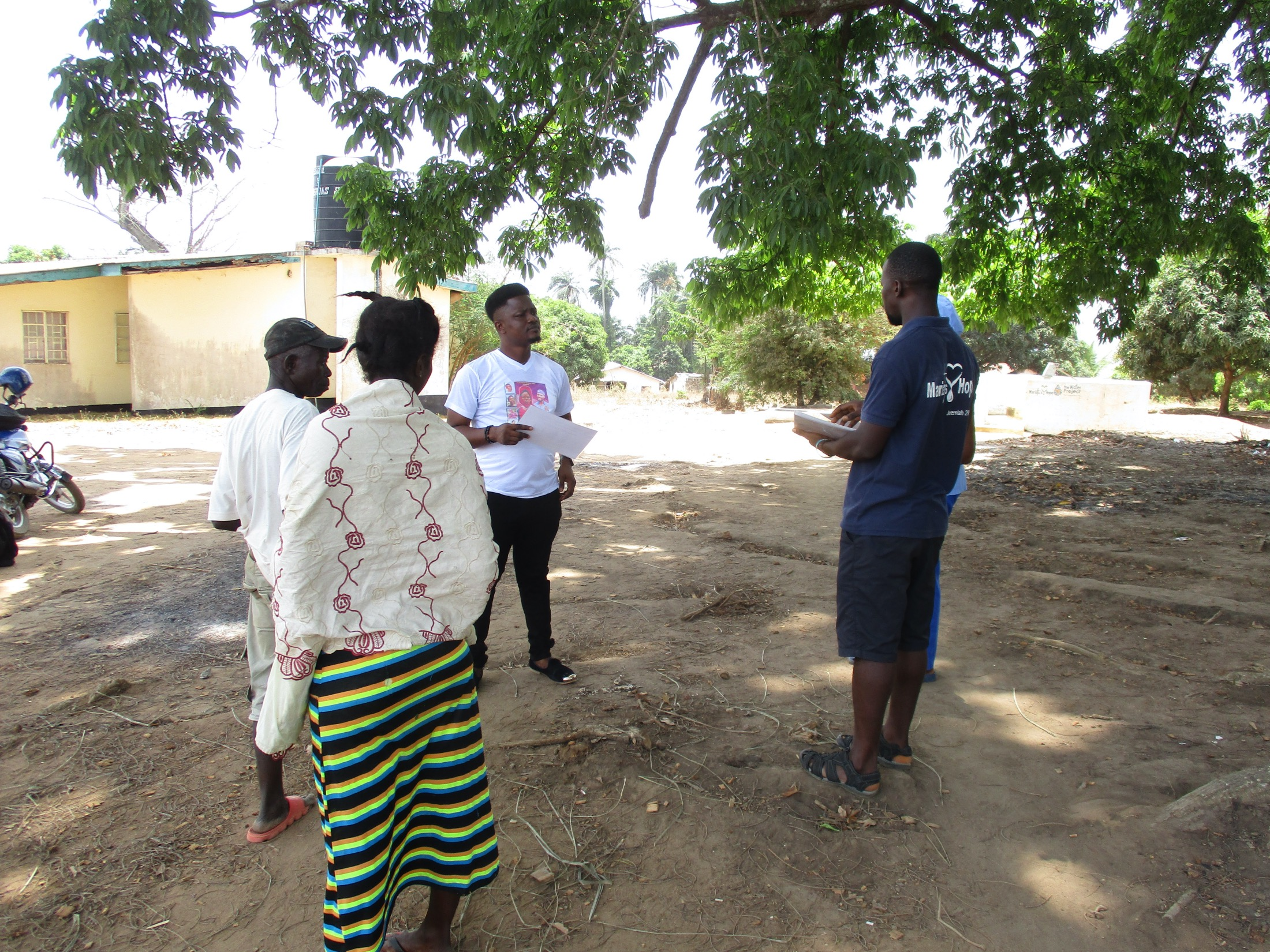 The Water Project : covid19-sierraleone19274-18264-staff-sensitizing-about-corona-virus-1