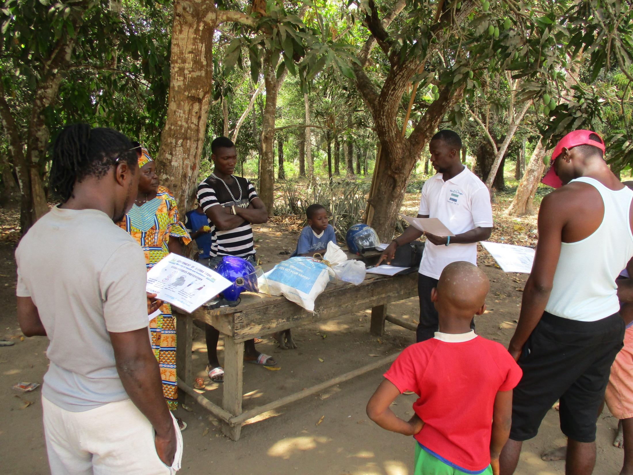 The Water Project : covid19-sierraleone5107-staff-sensitizing-community-members-about-corona-virus-2