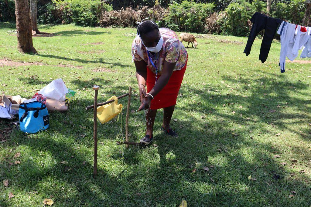The Water Project : covid19-kenya19159-handwashing-demonstration-at-the-new-handwashing-point