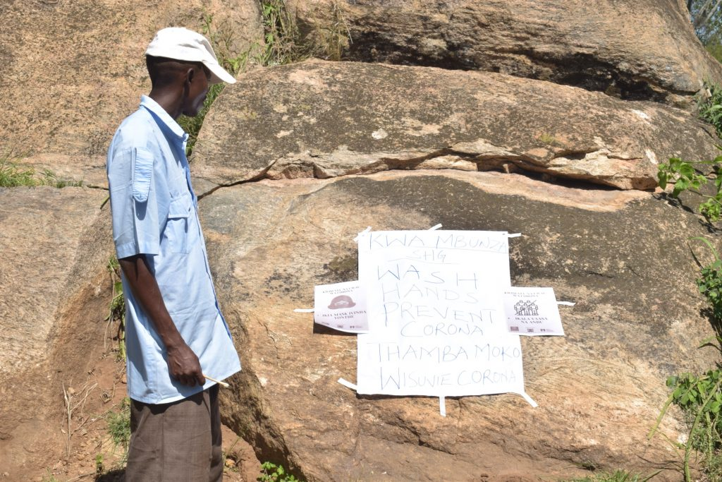 The Water Project : kenya19186-covid19-looking-at-covid-sign