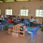 The Water Project: Kasioni Community C -  Trainer Leads Wash Training