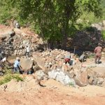 The Water Project: Kasioni Community B -  Digging At The Dam Site