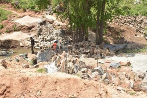 The Water Project:  Large Rocks For Dam