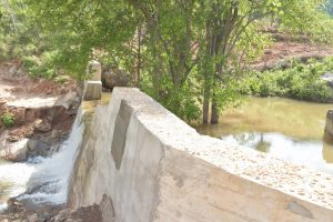 The Water Project:  Water Rushes Over Sand Dam