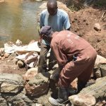 The Water Project: Kasioni Community C -  Hauling Rocks