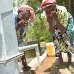 The Water Project: Kasioni Community C -  Drinking Fresh Water From The Well