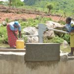 The Water Project: Kasioni Community C -  Filling Up At The New Well