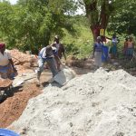 The Water Project: Kasioni Community C -  Mixing Cement