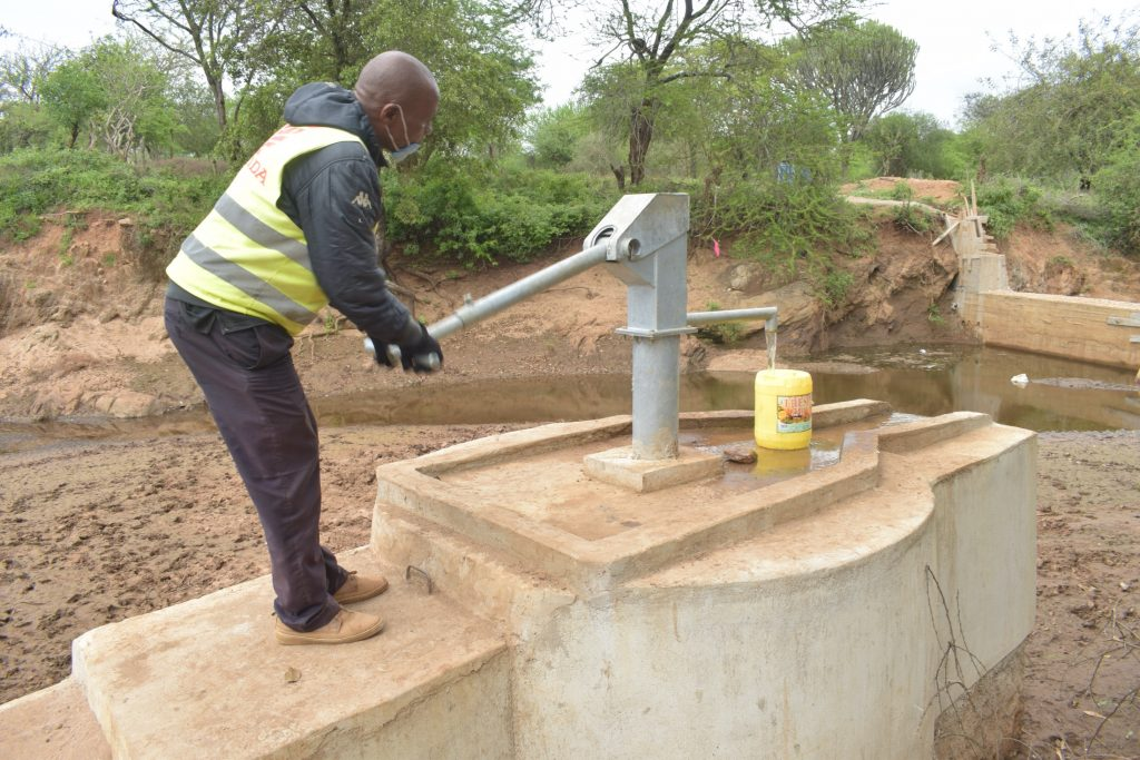 The Water Project : kenya20307-pumping-the-well-1