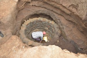 The Water Project:  Working On The Well Walls