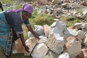 The Water Project:  Hauling Rocks